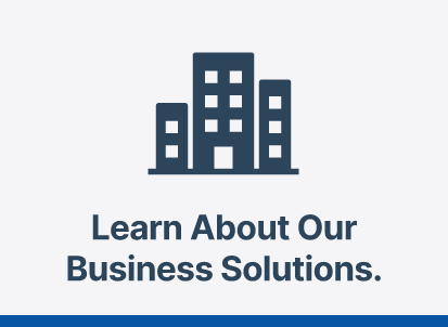 Graphic of blue buildings with text 'Learn about our business solutions.'